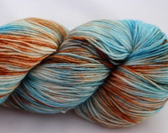 A Beautifully soft Hand dyed 4ply Yarn on a Super Wash Merino, Nylon base in the Stepping Stones colourway. A blend of soft blues and browns