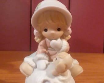"Avon Exclusive Precious Moments Porcelain figurine ""Hug Me Before I Melt"" 2001"