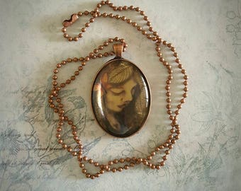 Antique copper pendant ~ 'Faith' ~ oval, with ball chain, sweet wee angel wearing a heart pendant.