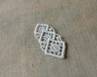 A white piece of vintage lace, handmade spindle