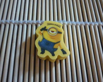 """Eraser character all """"MINION"""" yellow overalls, yellow background."""