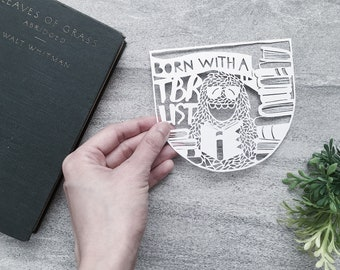 "Bookish Papercut Art, ""Born with a To-Be-Read List,"" Yeti Illustration, Handcut Paper Art for Room Decor, Mounted and Matted Available"