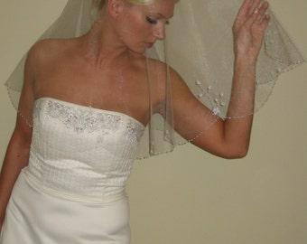 "Hand beaded wedding veil fingertip length circular cut 42"" long."