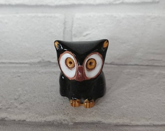 Small porcelain owl figurine. Cute but a little lost