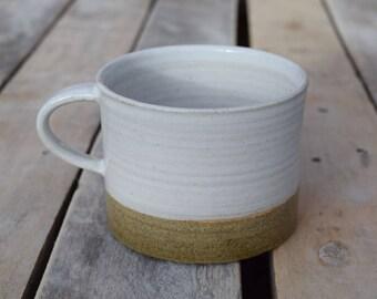 Ceramic mug in glossy white stoneware glaze with olive stripe