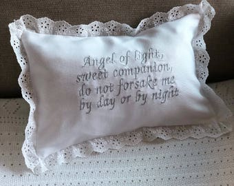 Baby pillow with lace and embroidered prayer