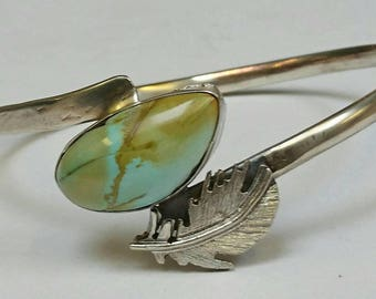 Sterling silver handmade royston turquoise oval bangle with hand pierced feather, hallmarked in Edinburgh