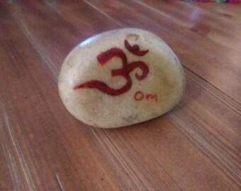 Hindu Om on Natural River Rock
