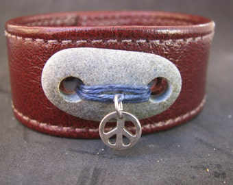 Unisex Leather Cuff with a Hand Stitched Stone and a Sterling Silver Peace Charm
