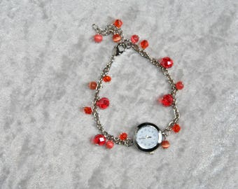 Shows red and coral glass beads