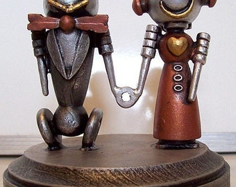 Robot Bride and Groom Wedding Cake Topper Classic V2 with Red Dress Holding Hands Wood Statues with Base