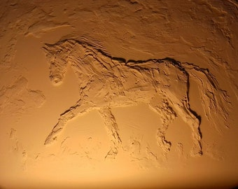 Bas-relief of a trotting horse