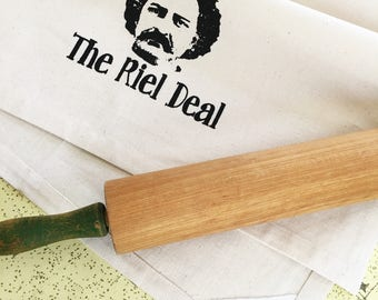 The Riel Deal organic kitchen dish towel. Manitoba Louis Riel silk screened cotton tea towel.