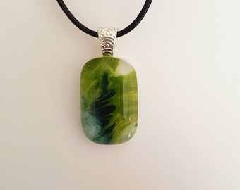 Swirly green and blue fused glass pendant