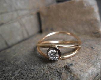 14K yellow gold ring set with a diamond solitaire