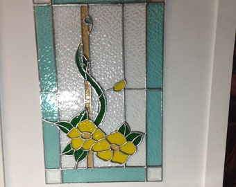 Handcrafted stained glass window panel made with English muffle glass.