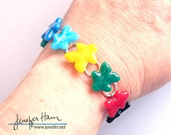 OOK - Sterling Silver and glass MEEPLE Bracelet! super cute meeple glass made by Jenefer Ham