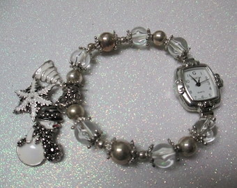 Vintage Christmas stretch watch with quality enameled charms signed Geneva Quartz water resistant used