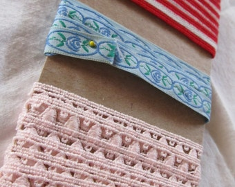 NOVELTY TRIM -pink eyelet loop, blue jacquard floral, red and white braided ribbon (approximately 3 1/2 yards total)