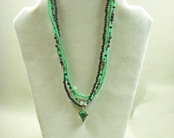 Electric green and black multi-stranded necklace