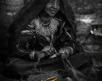 Tuareg women sewing a mattress with her hands