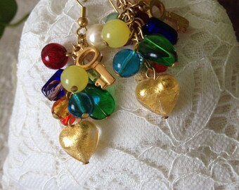 Earring Charms: Dangling earrings with glass charms.
