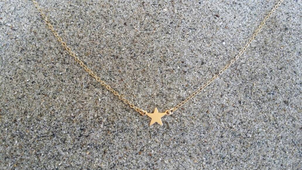 tiny pointed temperament pendant accessories item jewelry necklace horizontal necklaces delicate female sideways elegant star in from on models