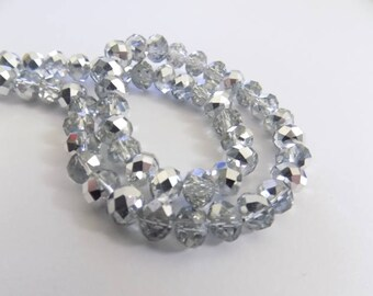 10 beads faceted glass clear and silver two-tone 6mmx8mm