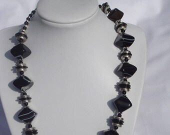 Black jazz: beaded necklace with black agate and onyx discs.