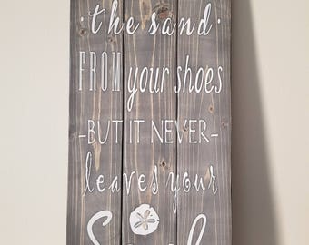 Sign - You can shake the sand from your shoes but it never leaves your soul - 3 panels