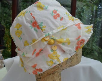 Flower sprigged frilly cotton lawn hat