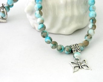 Butterfly Pendant Necklace with Light Blue Porcelain Beads 18 Inch Necklace
