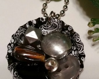 Bottle cap necklace,jewelry, beaded center. One of a kind