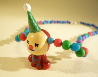 Colourful necklace with a little stylish Clown and a little hat on it!