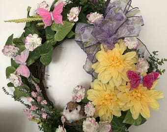Spring wreath with nesting bird