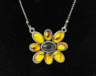 Vintage faux amber necklace with flower center