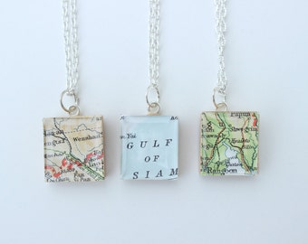 Recycled Scrabble Tiles and Atlas Map Travel Necklaces.