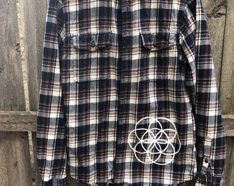 Size small (mens) flower of life flannel screen printed with wanderlust symol and seed of life