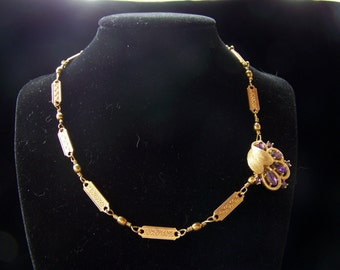 Pleasing purple and gold vintage looking necklace w earrings