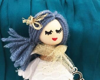 Brooch doll