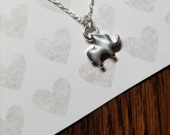 Teeny tiny silver good luck elephant necklace with pearl accent.