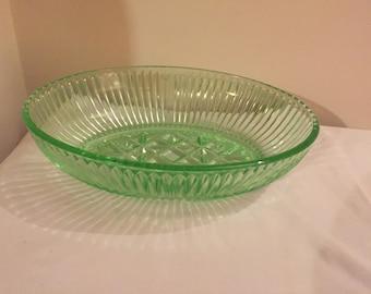 A heavy, vintage, uranium -green pressed glass bowl.