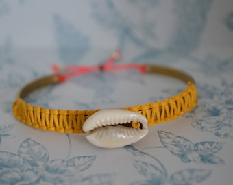 Brass bangle with seashell and braided cotton thread