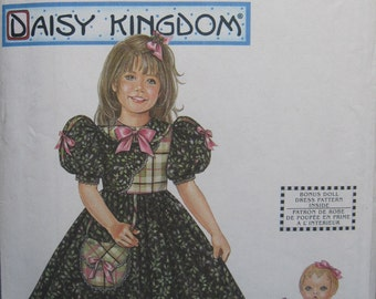 "Simplicity 9464 - Daisy Kingdom dress in sizes 3, 4, 5, 6/Includes matching dress pattern for 18"" doll. Pattern is uncut & factory folded."