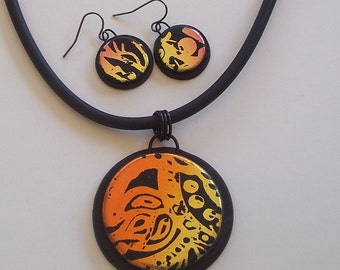 Orange and Gold Foil Patterned Round Black Polymer Clay Pendant and Earrings Set by Carol Wilson of PollyClayDesigns