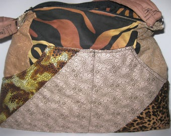 Quilted purse with browns, tans, animal print. My pattern with a lot of pockets