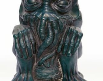 Green Cthulhu idol with a donation to Cancer Research UK