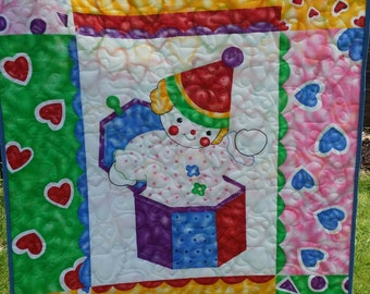 Jack in the Box childrens cot quilt or play mat
