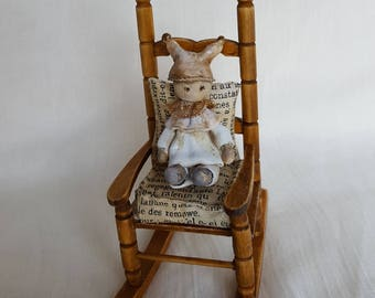Miniature rocking chair with doll