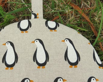 A cafetiere cosy, size small.   Made to fit a 2 cup cafetiere.  Penguins design.